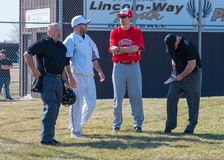 High school baseball coaches and umpires. Discuss the ground rules before the game Stock Photos