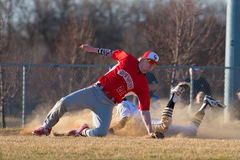 High school baseball runner slides Royalty Free Stock Photography