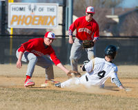 High school baseball shortstop tags sliding runner. Out second base Royalty Free Stock Image