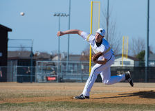 High School Baseball umpire. Throws a pitch from the pitching mound Royalty Free Stock Photo