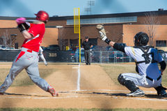 High school baseball umpire watches the batter and catcher Royalty Free Stock Photos