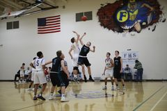 High school basketball game. Two high school basketball teams duke it out on the court royalty free stock photography