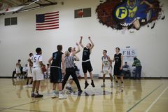 High school basketball match. A high school basketball match on an indoor basketball court royalty free stock photography