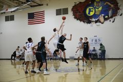 High school basketball teams. Two high school basketball teams on the court stock images