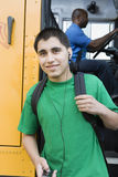 High School Boy With MP3 Player Getting Off School Bus Royalty Free Stock Photo