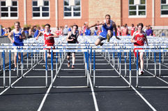 High school boys hurdles race Stock Photography