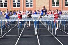 High school boys hurdles race Stock Photography
