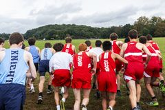 High school boys starting cross country race from behind royalty free stock photo