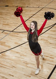High School cheerleader at a Basketball Game Royalty Free Stock Photography