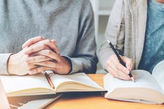 High school or college students studying and reading together in royalty free stock photography