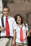 High School Couple In Uniform Holding Hands Royalty Free Stock Photo