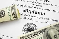 High school diploma. And cash Royalty Free Stock Photo