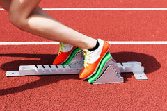 High School female sprinter in the blocks Royalty Free Stock Photography