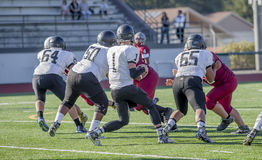 High school football game. Two high school football teams facing off during a game royalty free stock images