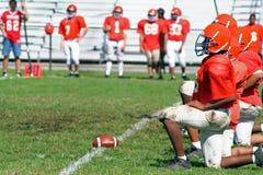High School Football Line. Kneeling Stock Images