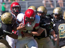 High School Football Player Being Tackled During a Game Stock Photo