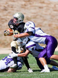 High School Football Player Being Tackled During a Game Royalty Free Stock Photography