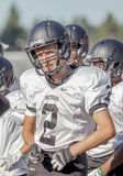 High school football player. A high school football player in costume on the field royalty free stock photo