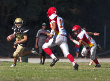 High School Football Player Running with the Ball Stock Images