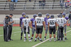 High School football players on field during game Royalty Free Stock Images
