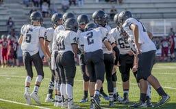 High school football players huddling Stock Images