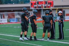 Football team at High school game. A high school football team discussing before the game royalty free stock image