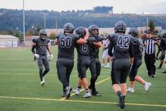 High school football team entering field. A high school football team entering the field Stock Images