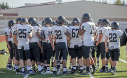 High school football team on pitch Royalty Free Stock Images