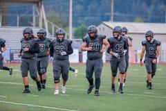 High school football team. A high school football team on the pitch royalty free stock photography