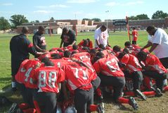 High school football team prays before the game in Suitland, Maryland stock images