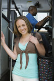 High School Girl Getting Off School Bus Royalty Free Stock Image