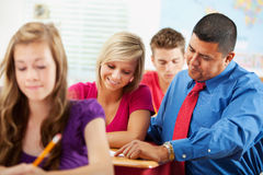 High School: Girl Happy To Have Teacher Help Royalty Free Stock Image