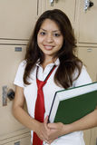 High School Girl Holding Textbook By School Lockers Royalty Free Stock Images