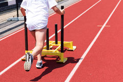 High school girl pushing a sled on a track Royalty Free Stock Photo