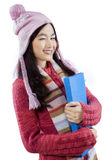 High school girl in winter clothes wink Royalty Free Stock Photo