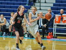 High school girls basketball players in action Royalty Free Stock Photo