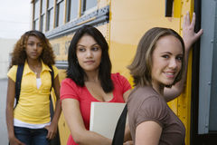 High School Girls Getting On School Bus Stock Photography