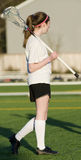 High School Girls Lacrosse. 17 yo High School Girls lacrosse player with stick over her shoulder Royalty Free Stock Photography