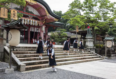 High school girls wearing school uniforms at Fushimi Inari shrine in Kyoto, Japan. Kyoto, Japan - June 22, 2010 - High school girls wearing school uniforms at stock images