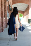 High school Graduate girl walking Stock Photo