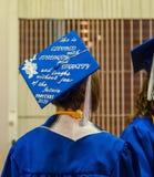 High school graduate with slogan on her mortar board. Corvallis, Oregon, June 2015: Female high school graduate wears mortar board with inspirational message Royalty Free Stock Photos