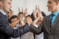 High school graduates shaking hands Royalty Free Stock Photo
