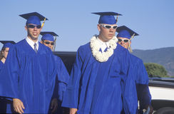 High school graduates wearing sunglasses Royalty Free Stock Photos