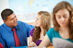 High School: Hispanic Teacher Helping Student Stock Images
