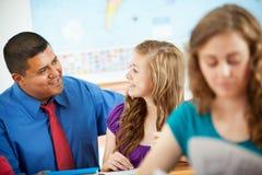 High School: Hispanic Teacher Helping Student Stock Images
