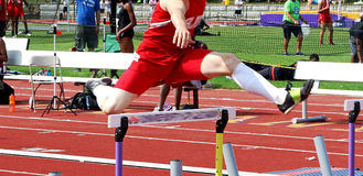 High school hurlder racing on a track Stock Photography