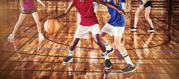High school kids playing basketball in the court stock image