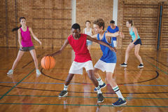 High School Kids Playing Basketball In The Court Royalty Free Stock Photography
