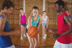 High school kids about to start playing basketball. In the court Stock Images