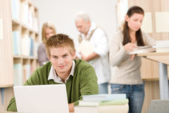 High school library - Student with book Stock Images